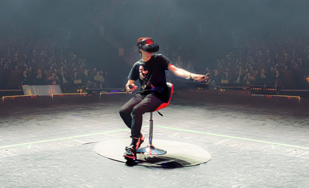 The Cybershoes are strapped directly onto your feet, and as you are seated in a swivel bar stool, you're ready to begin your VR adventure.